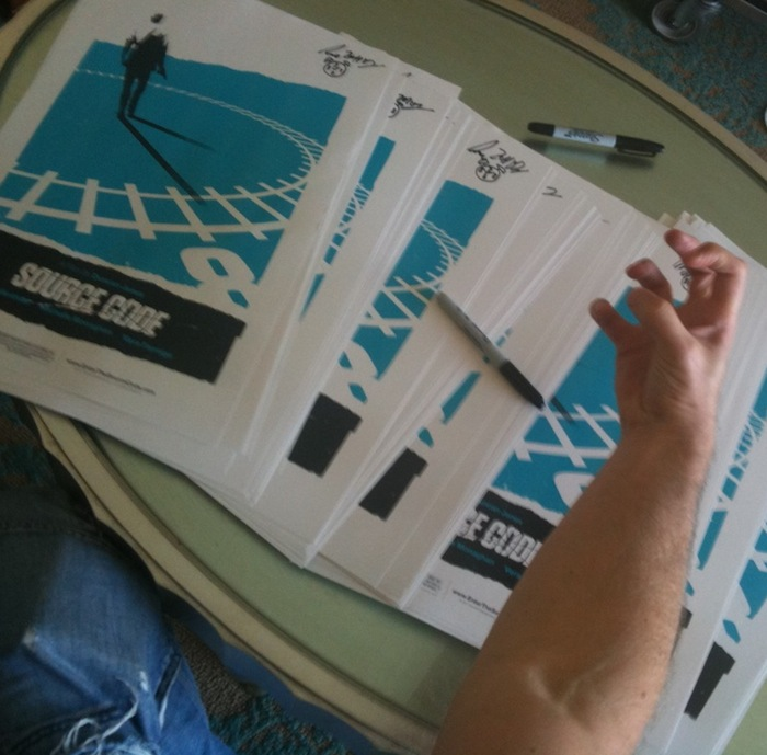 Duncan Jones Signs Olly Moss Source Code Posters LA March 18th 2011